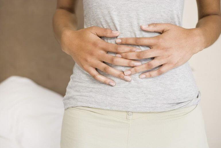 Почему возникает тяжесть в желудке